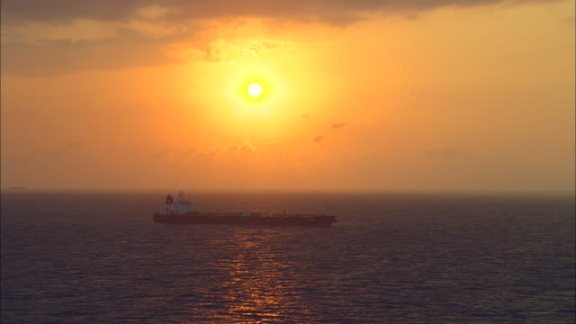 AERIAL Oil tanker in open water at sunset, Freeport, Bahamas