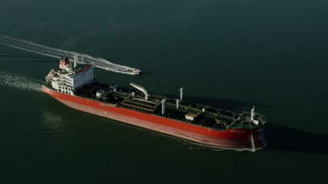 WS AERIAL POV TS Oil tanker moving in sea / Puerto Rico, United States