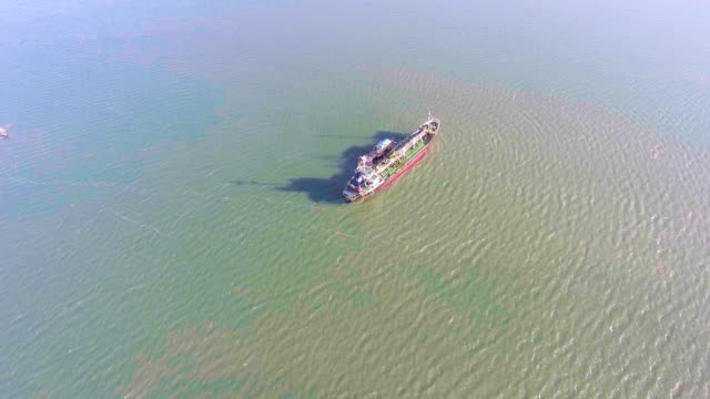 oil tanker ship aground on shallow water, aerial video - shipwreck stock videos and b-roll footage