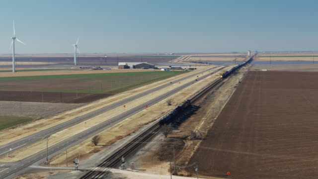 oil tanker train passing wind turbines - drone shot - propeller stock videos & royalty-free footage