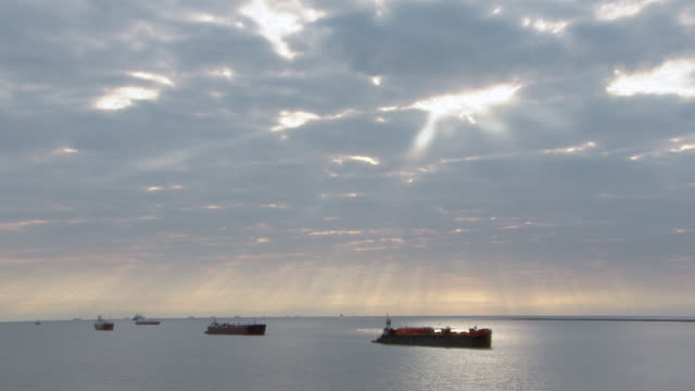 oil tankers sail under a glowing sky. - gulf of mexico stock videos & royalty-free footage