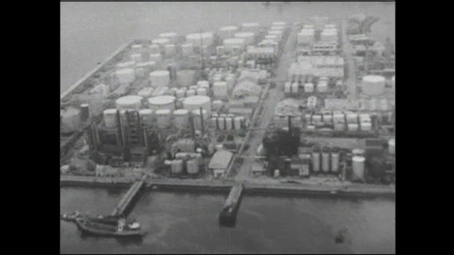 Oil tanks and an industrial complex border Yokkaichi Port  in Japan.