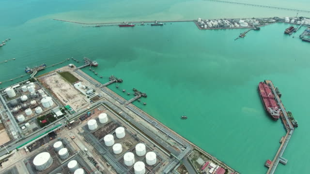 oil tanks and pipes in refinery on seashore, aerial view - generator stock videos and b-roll footage