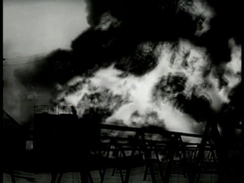 oil tanks exploding black smoke & large ball of fire. resistance sabotage subversion. - sabotage stock videos & royalty-free footage