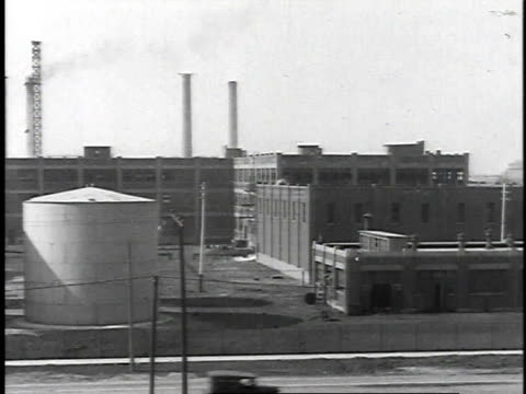 1923 ws oil tanks next to refinery / united states - 1923 stock videos & royalty-free footage