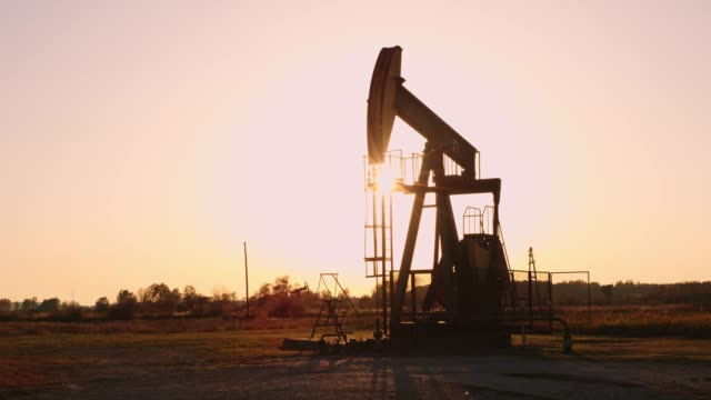 WS Oil well at sunset