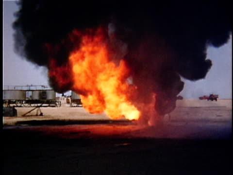 1956 ws composite oil well fire in desert, saudi arabia - saudi arabia stock videos & royalty-free footage