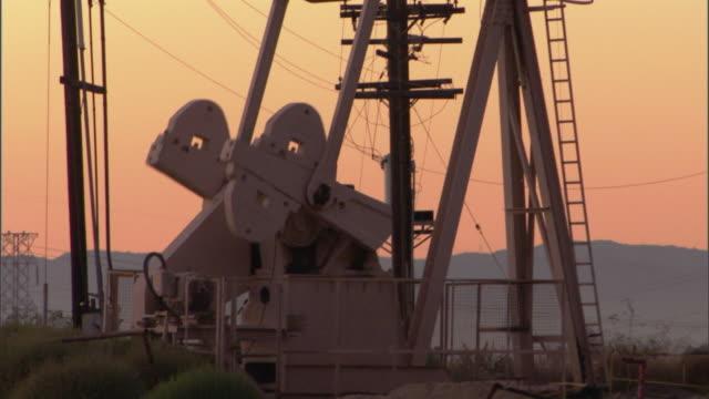 MS TU TD Oil well pump jacks against sky at sunset / Los Angeles, California, USA