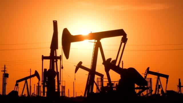 oil wells at sunrise - pump jack stock videos & royalty-free footage