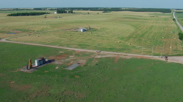 oil wells on oklahoma farmland - bale stock videos and b-roll footage