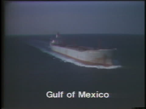 oil workers drill in alvin, texas while oil tankers cruise through the gulf of mexico. - gulf of mexico stock videos & royalty-free footage