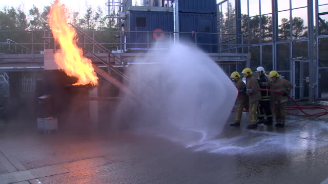 oil workers taking part in fire training in aberdeen - oil industry stock videos & royalty-free footage