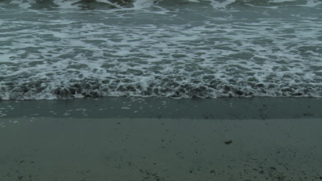 oily surf washes onto grand isle beach. - gulf of mexico stock videos & royalty-free footage