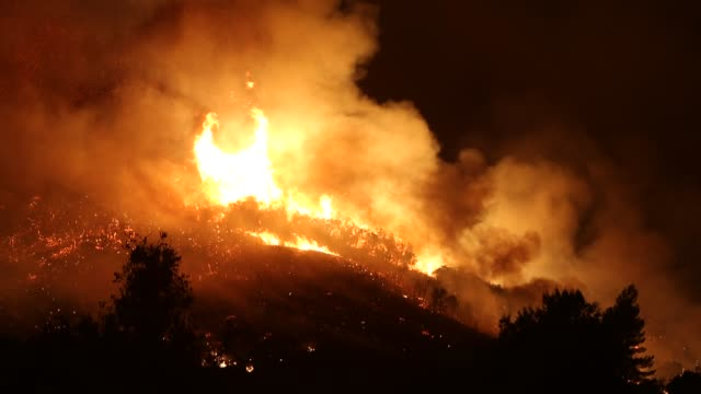 The Thomas Fire burns in the hills just beyond Ojai California December 7 2017 The fire had burned over 100000 acres by December 7 2017