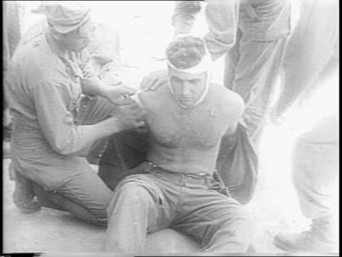 okinawa / flame throwing tank firing / soldiers advance across burning terrain / us marines marching to camera through heavy mud / marines' feet... - stillahavskriget bildbanksvideor och videomaterial från bakom kulisserna