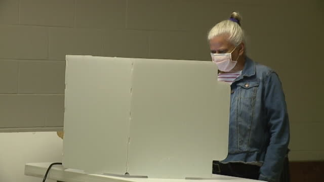 oklahoma city, in, u.s. - voters wearing face masks at voting booths during indiana primary election on tuesday, june 2, 2020. - booth stock videos & royalty-free footage