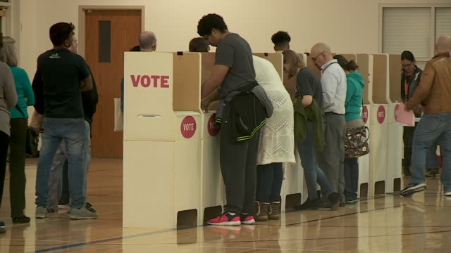 oklahoma city, ok, u.s. - people at voting booths in polling station on super tuesday. oklahoma city on tuesday, march 3, 2020. - booth stock videos & royalty-free footage