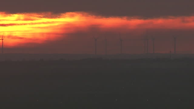 oklahoma city, ok, u.s. - wind turbines in field at sunset on wednesday, january 20, 2021. - dramatic sky stock videos & royalty-free footage
