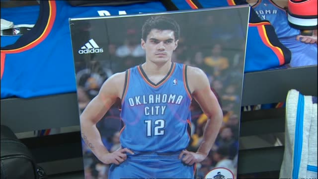 oklahoma city thunder nba replica jerseys on display at foot locker retail store before steven adams publicity event in 2014 - oklahoma city thunder basketball team stock videos and b-roll footage