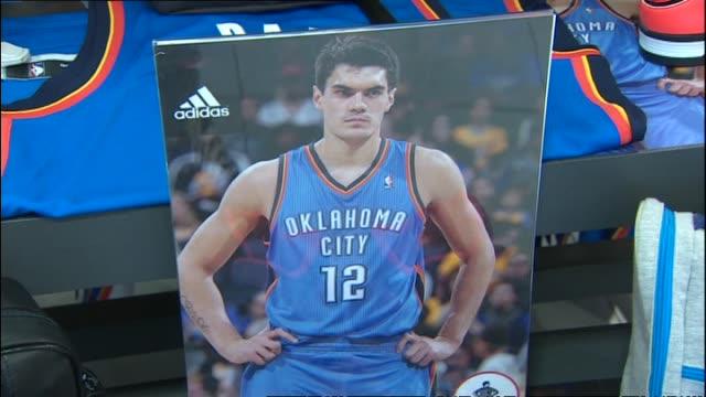 Oklahoma City Thunder NBA replica jerseys on display at Foot Locker retail store before Steven Adams publicity event in 2014