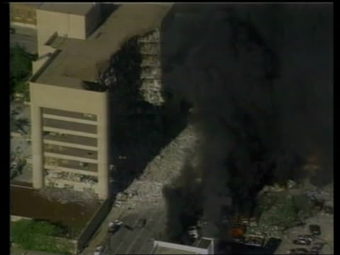 oklahoma: oklahoma city: ext 1995 air view black smoke pouring from bombed alfred p murrah federal high rise building lms firefighter beside line of... - bomb stock videos & royalty-free footage