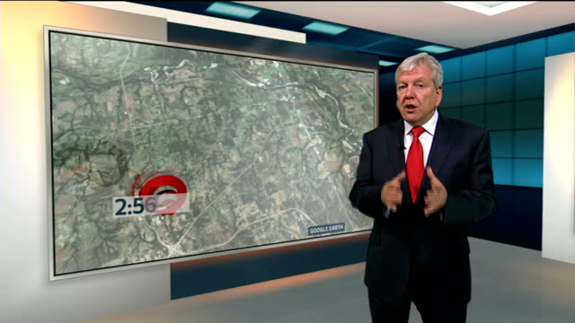 conditions that create tornadoes england london gir int reporter to camera with videowall reading andrew barrett interview sot - oklahoma stock-videos und b-roll-filmmaterial
