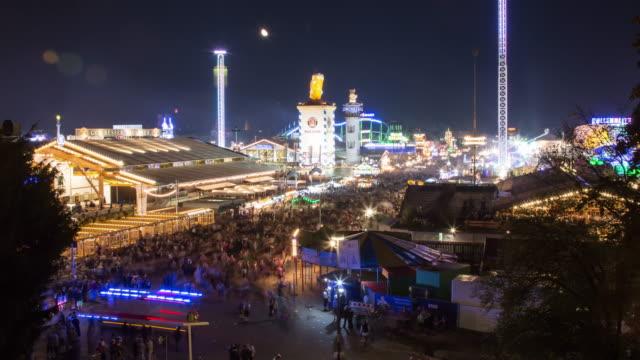 oktoberfest 2015 munich - timelapse-1 - moon rising and lights going off - oktoberfest stock videos & royalty-free footage