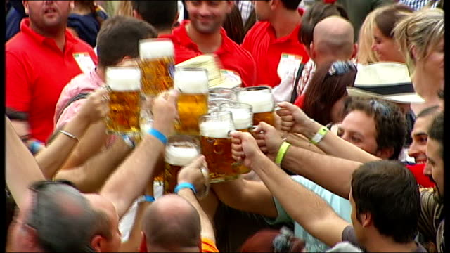 oktoberfest celebrations man drinking stein in one go / large group of men clinking steins before drinking / people driking / band playing - beer stein stock videos and b-roll footage