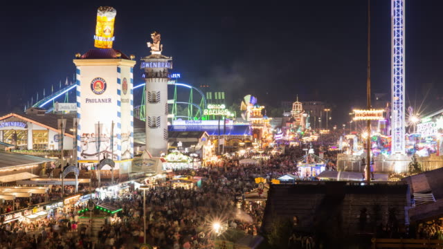 oktoberfest'15 munich - timelapse3 - motion-blur and lights going off - munich stock videos & royalty-free footage