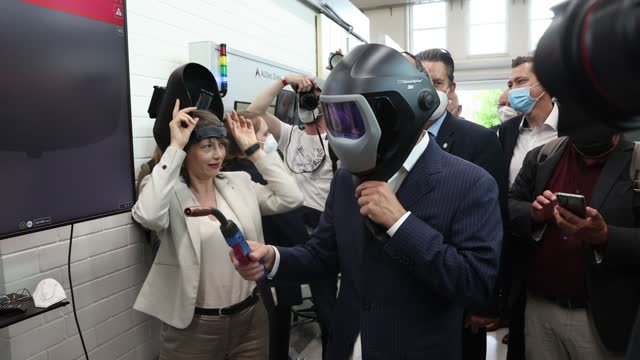 olaf scholz, german finance minister and chancellor candidate of the german social democrats , tries on a welding helmet while visiting the slv halle... - welding helmet stock videos & royalty-free footage