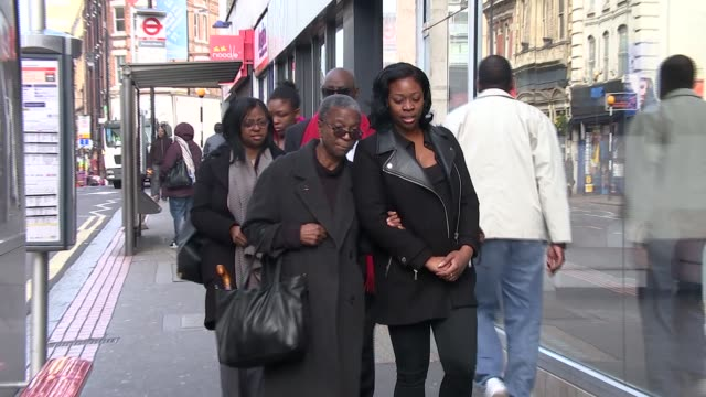 Olaseni Lewis inquest hears from police officer who teaches restraining techniques ENGLAND London Croydon EXT Various of family of Olaseni Lewis...
