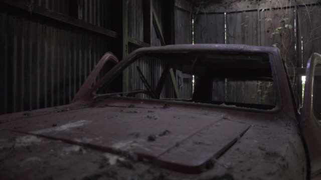 old abandoned 3 wheeled robin reliant car in farm barn - barn stock videos & royalty-free footage