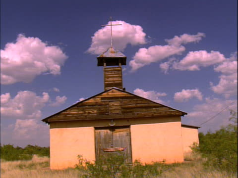 old, abandoned church with adobe and wood sides - adobe material stock videos and b-roll footage