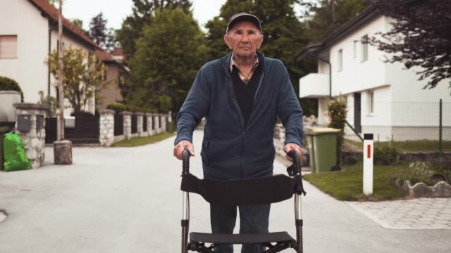 old age pensioner walking with a help of walker - mobility walker stock videos and b-roll footage