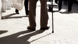 Old age pensioner walking with stick