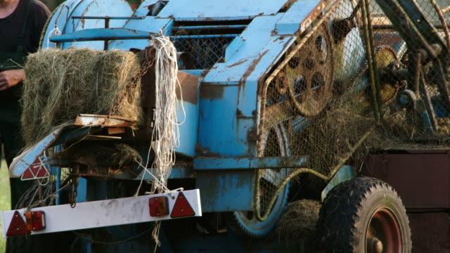 old agro machine - hay baler stock videos & royalty-free footage