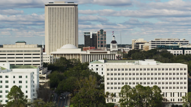old and new capitol compex in tallahassee, florida - aerial - florida us state stock videos & royalty-free footage