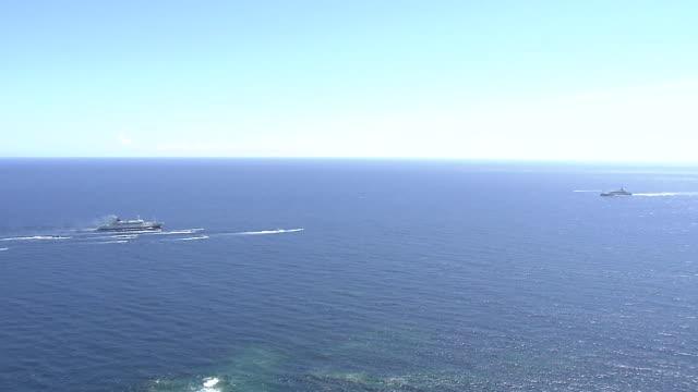 old and new ogasawara-maru ferries, ogasawara islands, japan - フェリー船点の映像素材/bロール