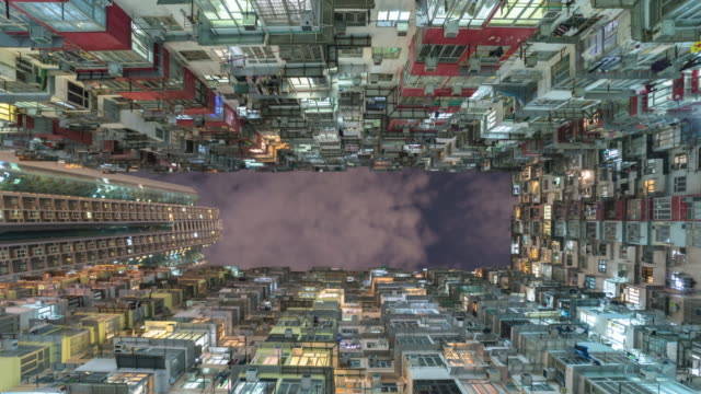 old apartment building in hong kong with sky, tilt down time lapse Video.