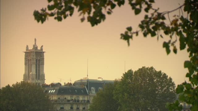 ms old apartment buildings with saint-jacques tower in background / paris, france - 16th century stock videos & royalty-free footage