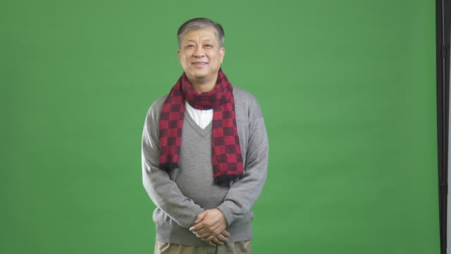 old Asian man with grey jumper and red scarf 4k