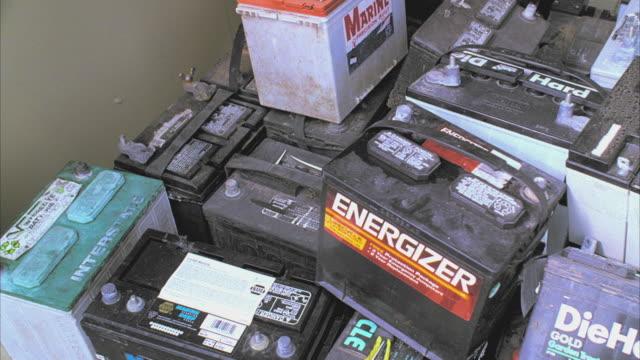 cu pan old batteries in storage building, santa barbara, california, usa  - heap stock videos & royalty-free footage