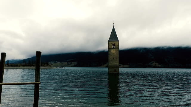 Old bell tower under the lake