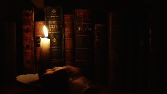 old bible -  chosen with candlelight - 19th century style stock videos and b-roll footage