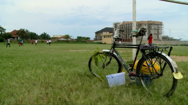 old bicycle leaning on goal post, harare, zimbabwe - harare stock videos and b-roll footage