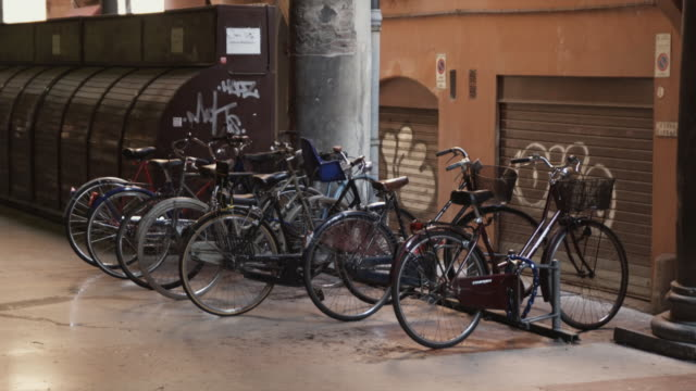 WS Old bikes parked at rack / Bologna, Italy