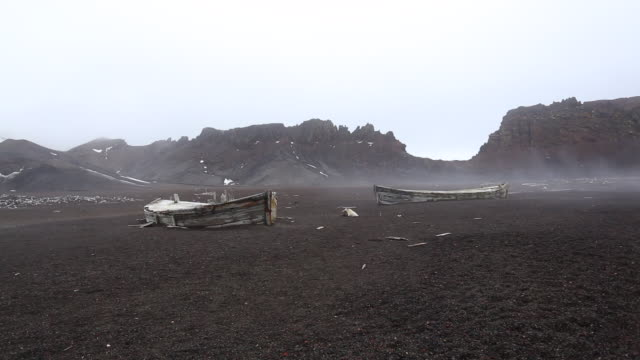 old boats at whaling station, deception island, antarctica - whaling stock videos & royalty-free footage