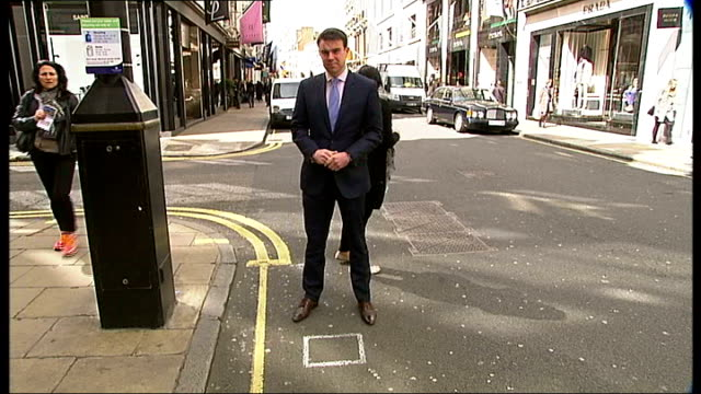 old bond street remains europe's most expensive street reporter to camera sot dickinson interview sot shoppers along street passing flagship stores... - flagship store stock videos and b-roll footage