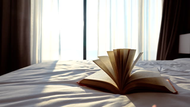 old book in bedroom - open book stock videos & royalty-free footage