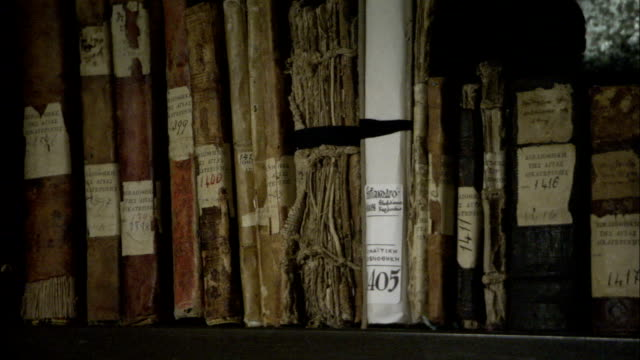 Old books and manuscripts line a shelf at Saint Catherine's Monastery in Mount Sinai Egypt. Available in HD.